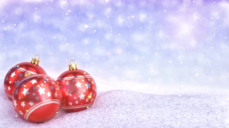 dekorasyon : red christmas balls in snow on bokeh background - 3D render. Seamless loop Stok Video