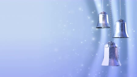снежинки : three rotating blue silver christmas bells with glitter bokeh background. Seamless loop. 3D render