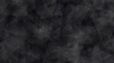 Abstract background of moving triangles black color. Abstract animation background of triangles that move, focus and blur in black tones.