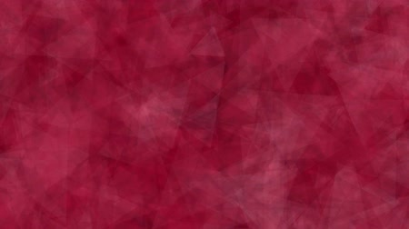 Abstract background of moving triangles red color. Abstract animation background of triangles that move, focus and blur in red tones. Stok Video