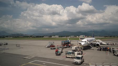 meteorological : Timelapse of Aircraft boarding at Bergamo Airport, Milan, Italy