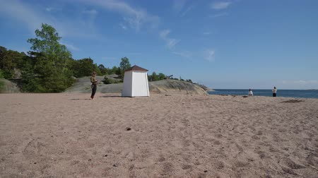 Timelapse at Hanko beach with iconic changing room Stock Footage
