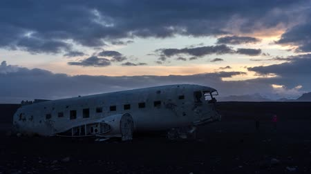 Sunset Timelapse of tourists climbing on wrecked DC3 Stock Footage