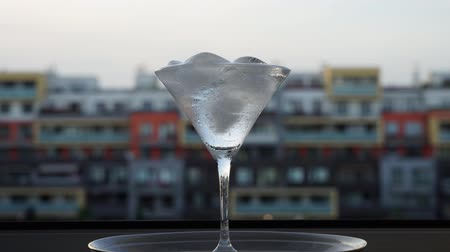 Timelapse of Ice Melting in a Martini glass on a Hot Summers Day