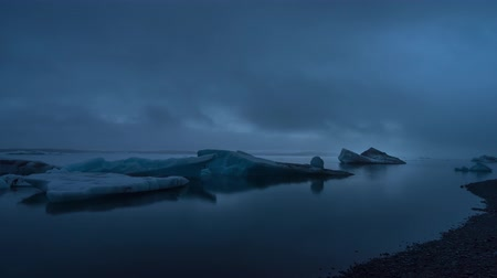 Evening Timelapse of icebergs in Jokulsarlon Glacier Lagoon under low clouds Stock Footage