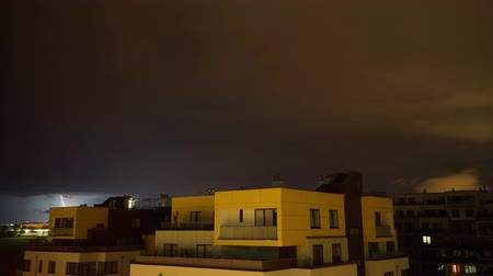 Timelapse of heavy lightning storm rolling over apartment buildings in Prague, Czech Republic