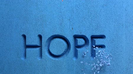 willpower : Animation of hope word carved in stone wall Stock Footage