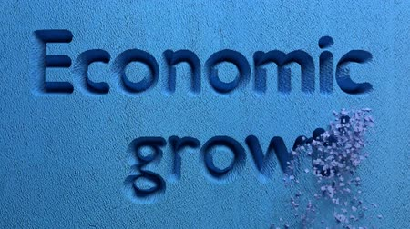 enflasyon : animation of economic growth word carved in a stone wall