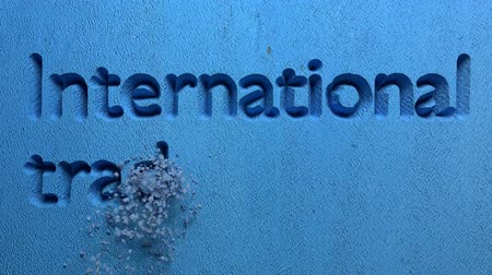 multinational : animation of International trade word carved in a stone wall Stock Footage
