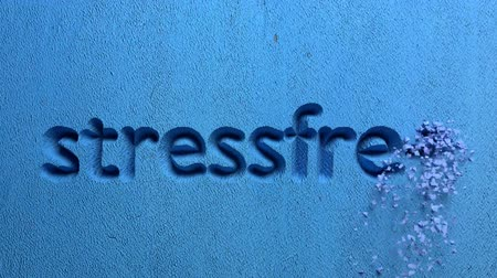 balanced : animation of stressfree word carved in a blue wall Stock Footage