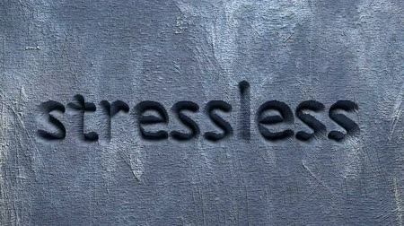 animation of stressless word carved in a gray wall