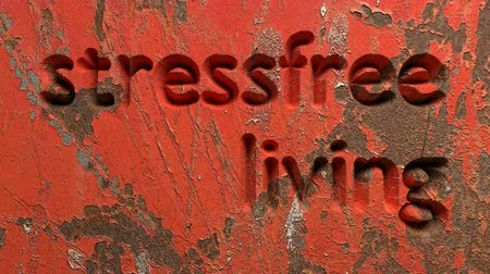 animation of stressfree living word carved in a red wall