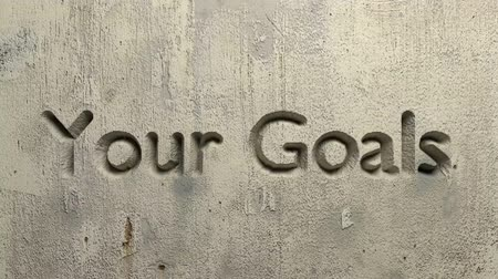 animation of your goals word carved in a gray wall