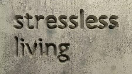 animation of stressless living. word carved in a gray wall