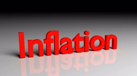 Inflation text in red letters dissolves into particles and disappears Stock mozgókép