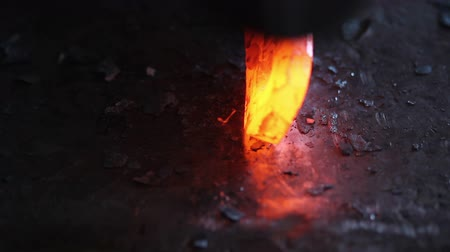 coal fired : Forging hot metal in smith with hand hummer