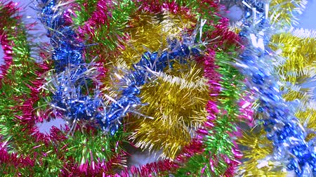 Christmas tinsel, frippery falls on the table. New year, Christmas, holidays.