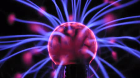 плазма : Closeup view of plasma ball with moving energy rays inside on black background