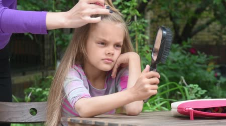 uzun : Girl bored until my mother braids her long hair and looking at the reflection in the mirror