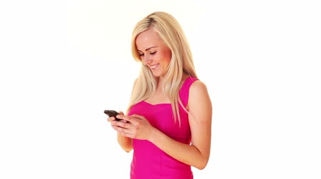 sobre o branco : young blonde woman texting with mobile phone, over white background