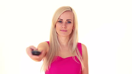фронт : young blonde woman with tv remote, over white background Стоковые видеозаписи