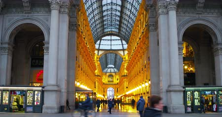 milan fashion : MILAN, ITALY - JANUARY 9, 2017: Outside Galleria Vittorio Emanuele II in Milan, Italy - a famous shopping mall - blurred travel backgrounds Stock Footage