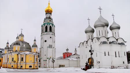 torre sineira : Vologda, Russia. Kremlin square in Vologda, Russia with old church and Saint Sophia Cathedral in winter with snow
