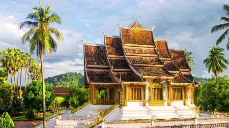 prabang : Luang Prabang, Laos. Famous temple in Luang Prabang, Laos with cloudy sky. Time-lapse in the sunny evening