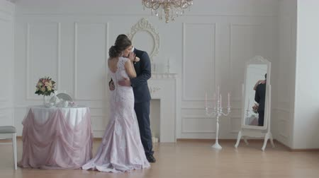 evli : Happy groom and bride. Happy and cheerful wedding couple showing tender feelings to each other Stok Video