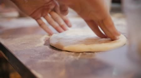hamur : Chef Tossing Pizza Dough. Skillful chef preparing a pizza Stok Video
