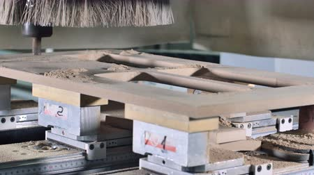 zpracování dřeva : Timelapse of milling cutting wood machine. Fast forward of milling grooves, curved surfaces and drill all the required holes for the pieces of wood