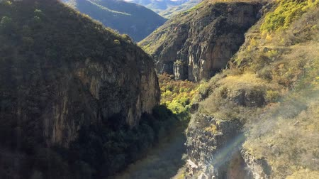 armenia : 4K aerial shot mountain gorge and cliff with sun leaks Stock Footage