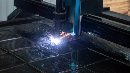 metalurgia : time lapse of plasma cutter. Plasma robotic industrial equipment works with metall sheet.