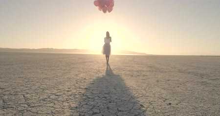 rachaduras : A girl with balloons walking in the desert Lake El Mirage. Drone. October 2017