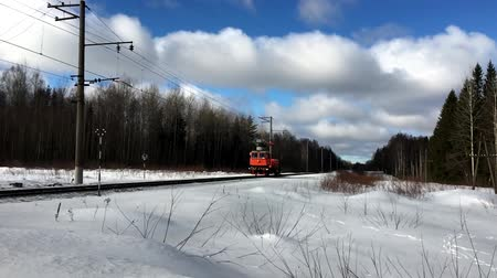 lineman : Railway lineman rides in winter on a forest track. Transportation rail in Russia.