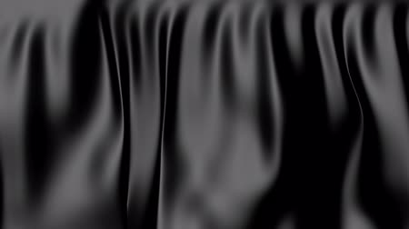 hajtogatott : The movement of black fabric folded. The background fabric in motion.