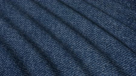 roto : Movement denim blue material folds. The background fabric in motion.