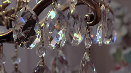 wedding and gold : Glass of sparkling colors charms. Clear cut crystal pendants. Stock Footage