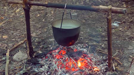 Pot on fire in the camping. The romance of Hiking by nature. In the camp.