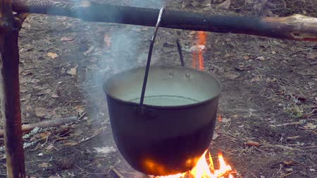 tűzifa : Pot on fire in the camping. The romance of Hiking by nature. In the camp.