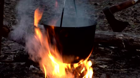 Boiling water on fire in a hike. Romance hiking by nature. Cooking and drinking tourists on a halt. Wideo