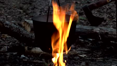 fireside : Boiling water on fire in a hike. Stock Footage
