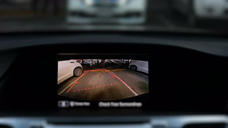 fatality : rear view digital display of back camera in car with driving in parking lot