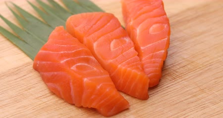 salmon slices on wooden chopping board preparation cooking japanese food