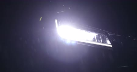 headlight vehicle car open in rainy night street road 動画素材