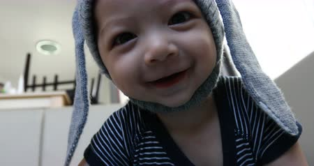 cute baby happy smile wearing rabbit wool hat Wideo