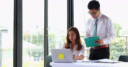 asian business man and woman working team in office