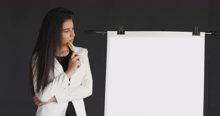 beautiful working woman thinking presentation with blank white board in front of meeting room business office