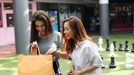 beautiful asian women happy shopping time in lifestyle mall