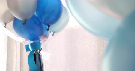 blue and white balloon floating decoration in birthday anniversary celebration party